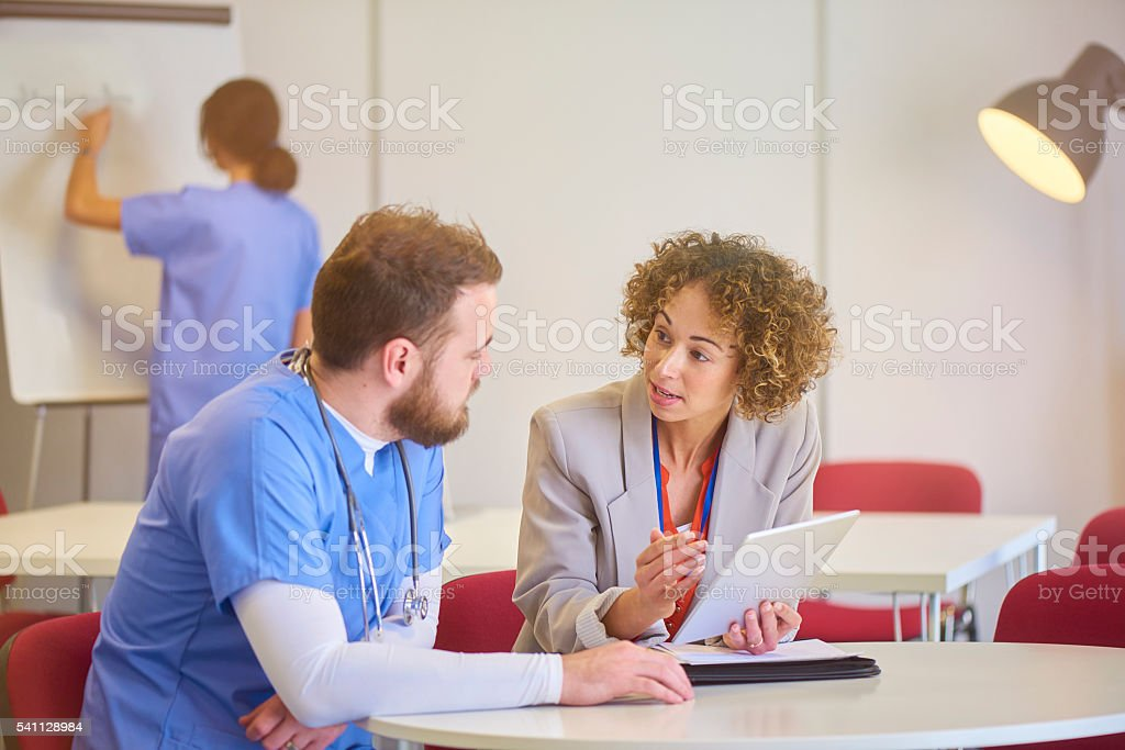 consultant with male nurse stock photo