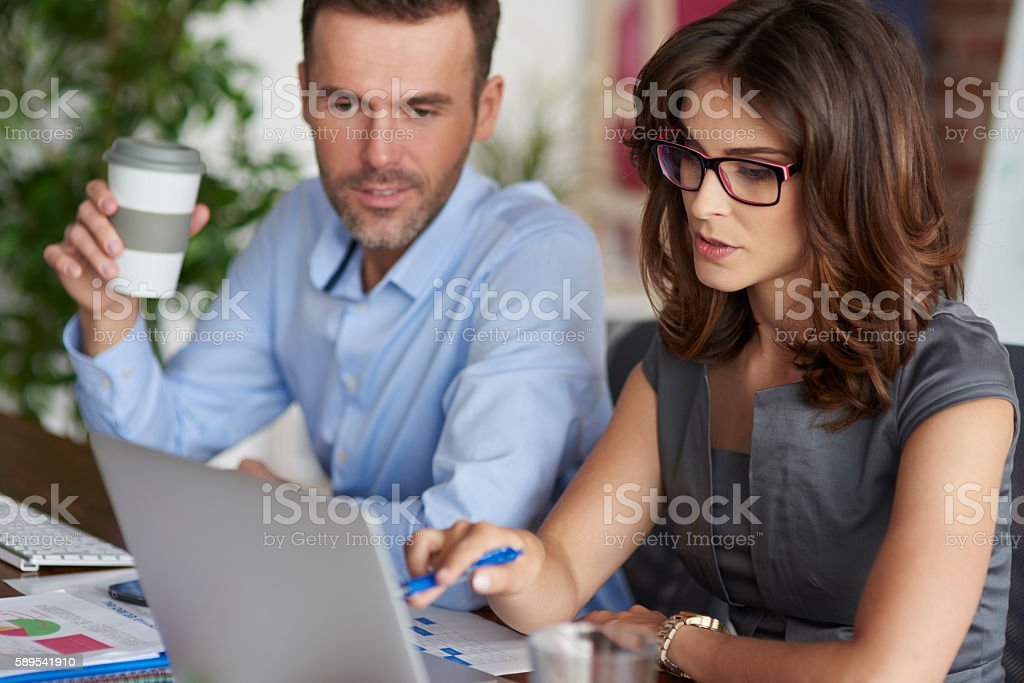 Consultation of two professional office workers stock photo