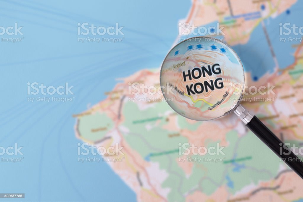 Consultation with magnifying glass map of Hong Kong stock photo