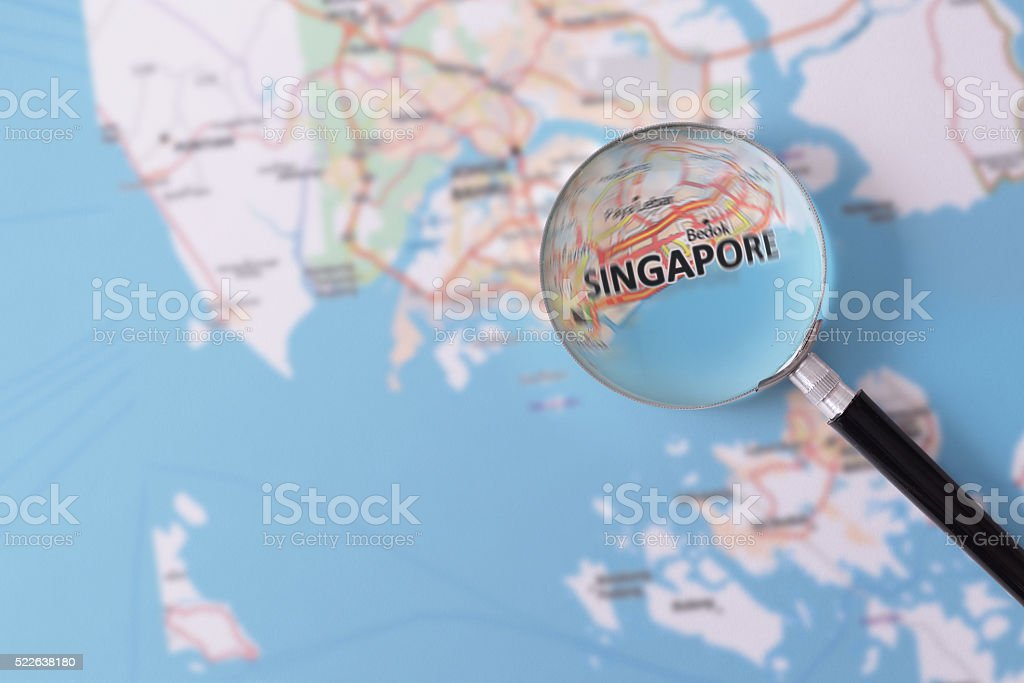 Consultation with magnifying glass map of Singapore stock photo