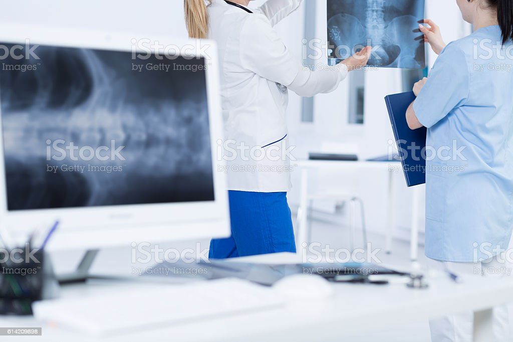 Consulting a questionable case with senior doctor stock photo