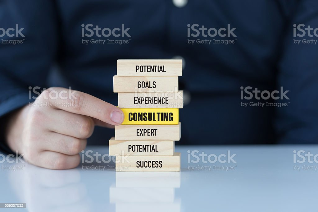Consulting Concept with Related Keywords on Wooden Blocks stock photo