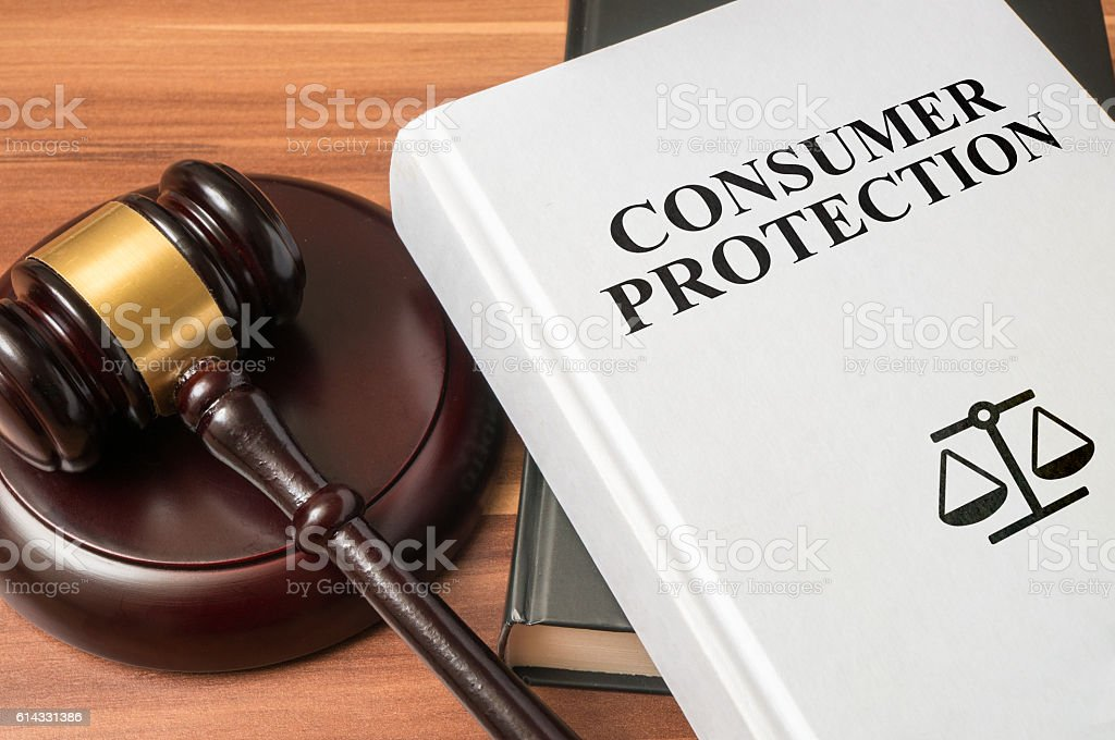 Consumer protection book and gavel. Law and regulations concept. stock photo