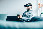 Consumer wears VR glasses and plays game at home