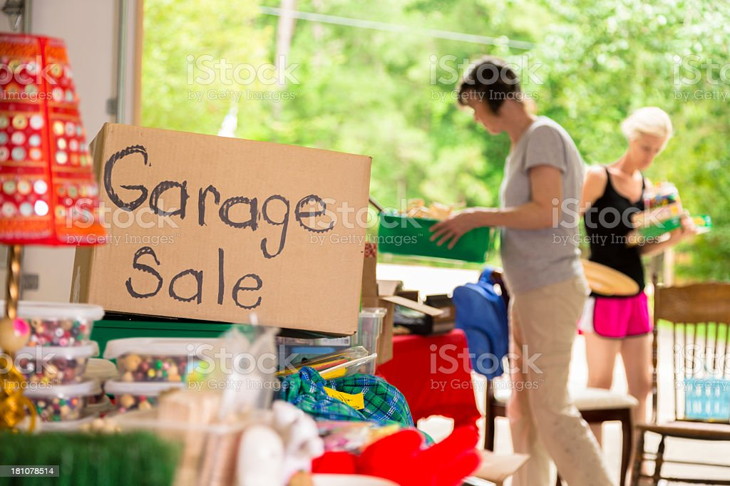 Consumerism:  Adult women shopping at a garage sale in suburbs stock photo