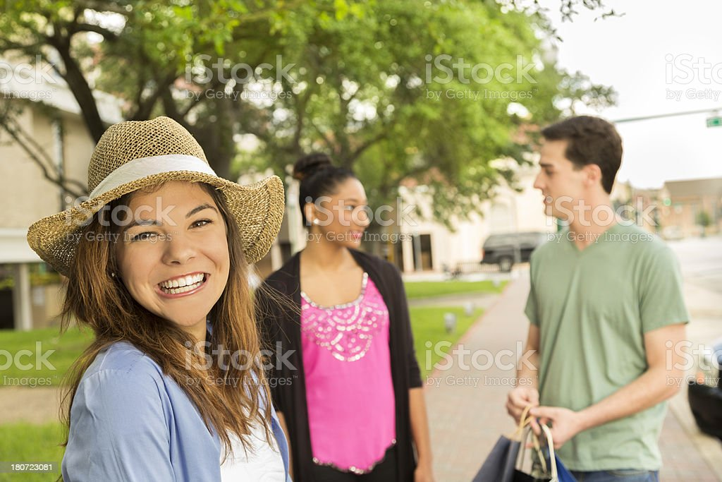 Consumerism:  Happy young adults and teens shopping downtown USA. royalty-free stock photo