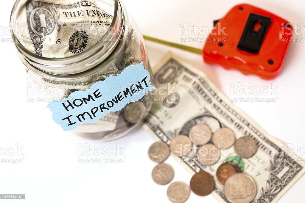 Consumerism:  Money Jar.  Saving for home improvement. Concept. royalty-free stock photo