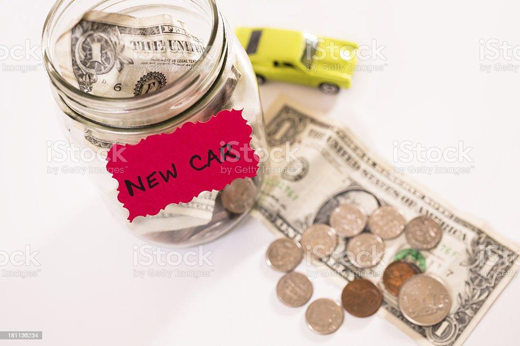 Consumerism:  Money Jar.  Saving for new vehicle. royalty-free stock photo