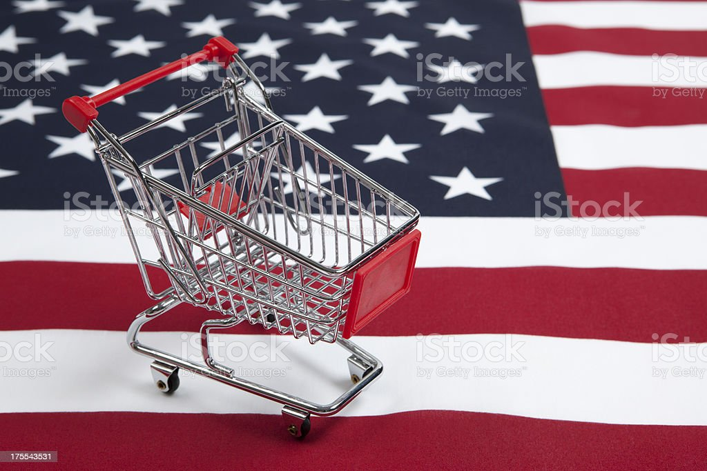 Consumerism: Shopping Cart with American Flag royalty-free stock photo