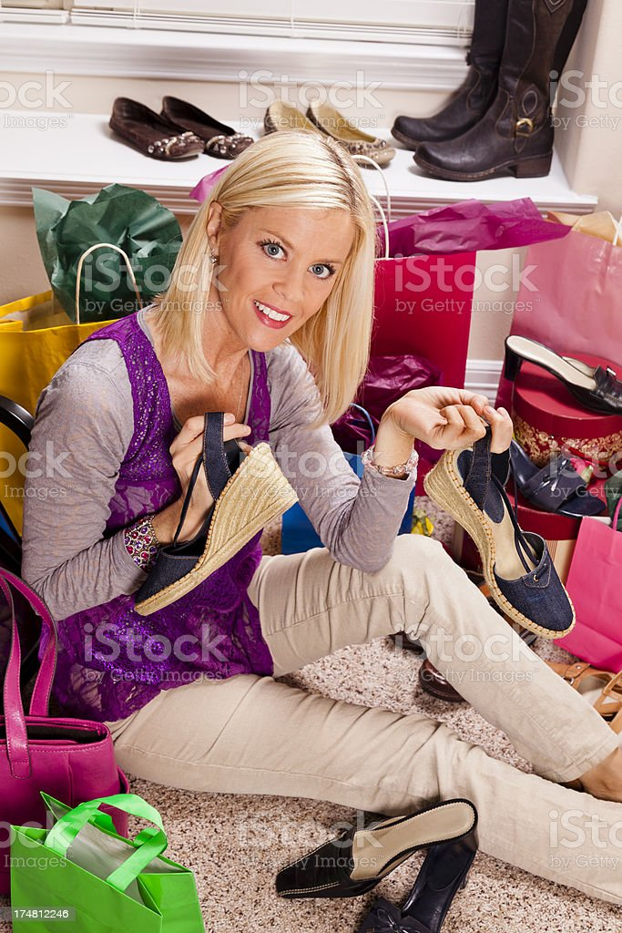 Consumerism.  Woman shopping wedge shoes and heels. royalty-free stock photo