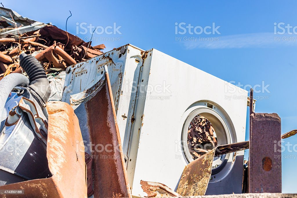 consumerist chaos of ferrous in a washing machine stock photo