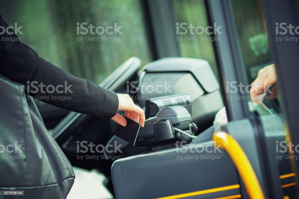 Contacless payment with RFID card on the public transportation stock photo