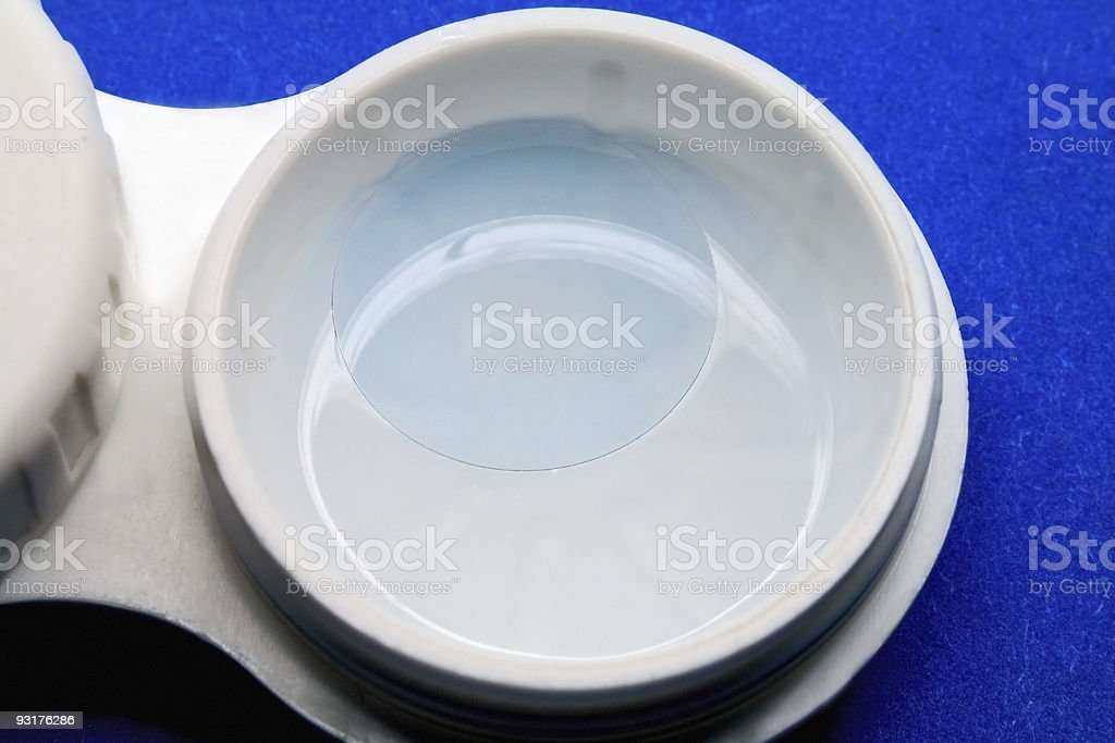 Contact lens in a solution stock photo