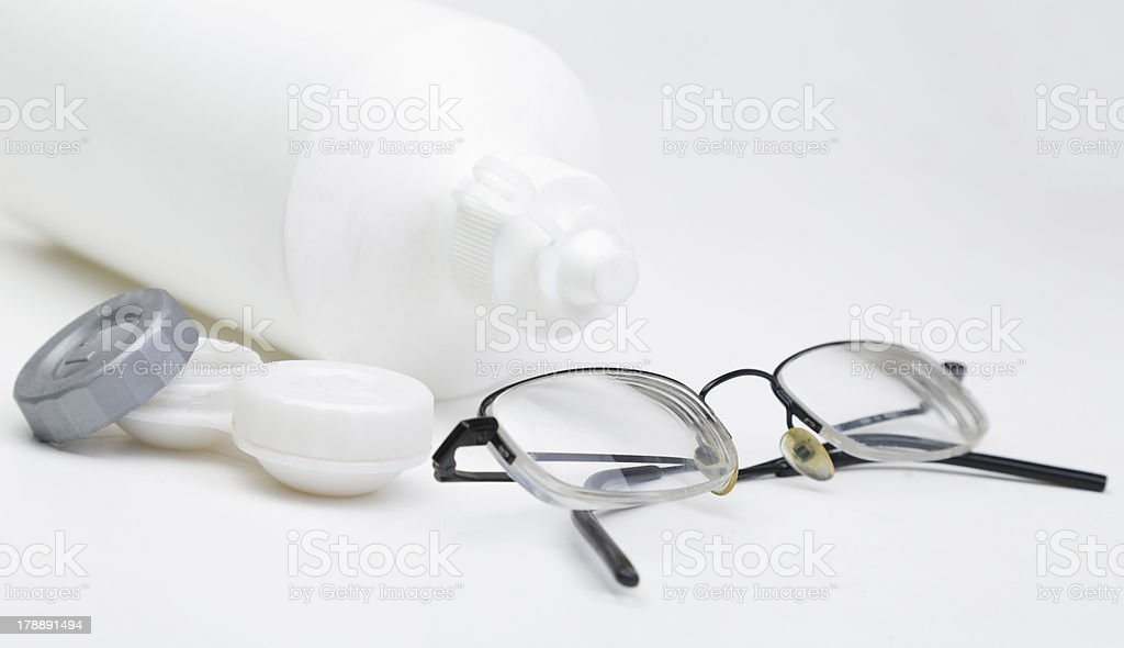 Contact lenses and glasses royalty-free stock photo