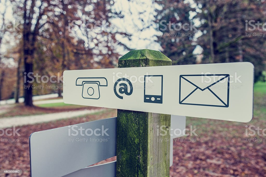Contact signboard in an autumn park stock photo