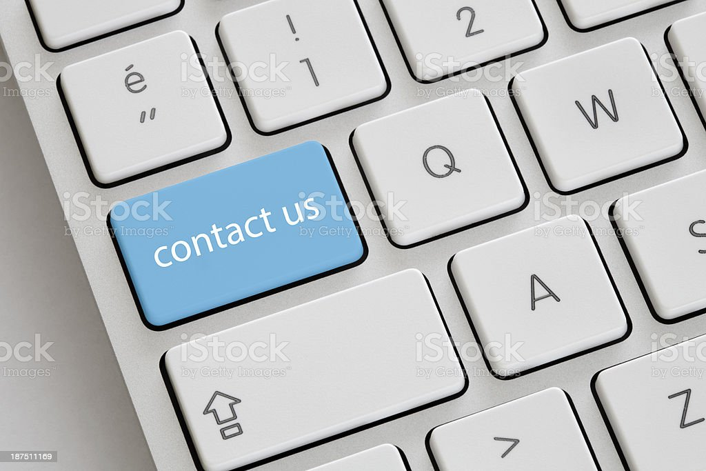 A contact us button on a keyboard stock photo