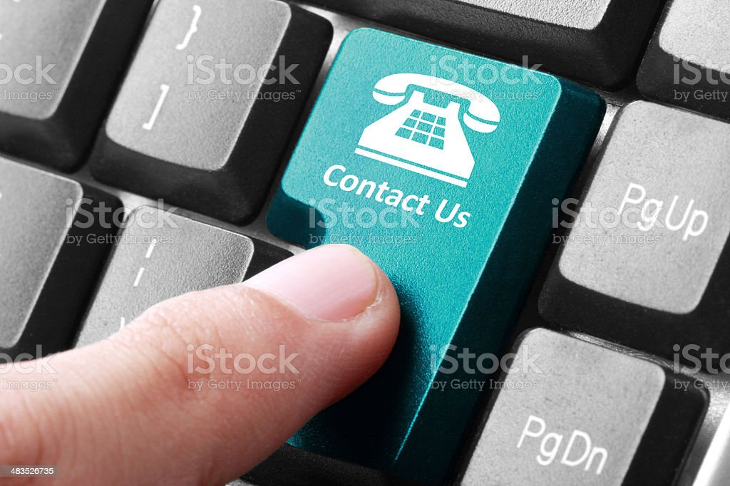 Contact us button on the keyboard stock photo