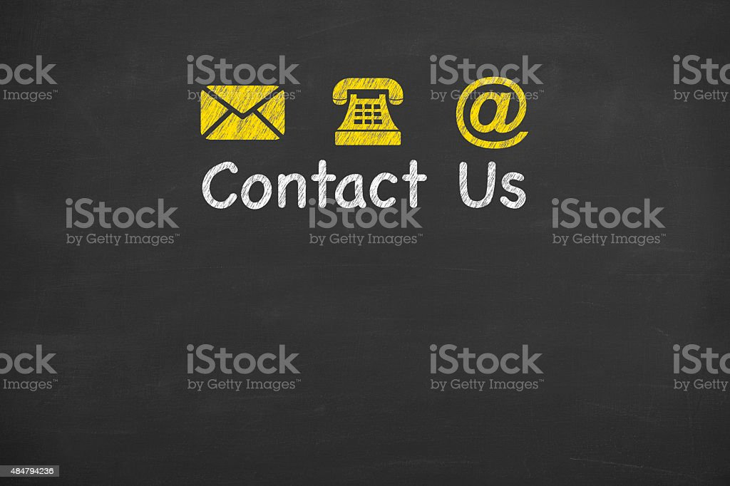 Contact Us Concept on Blackboard stock photo