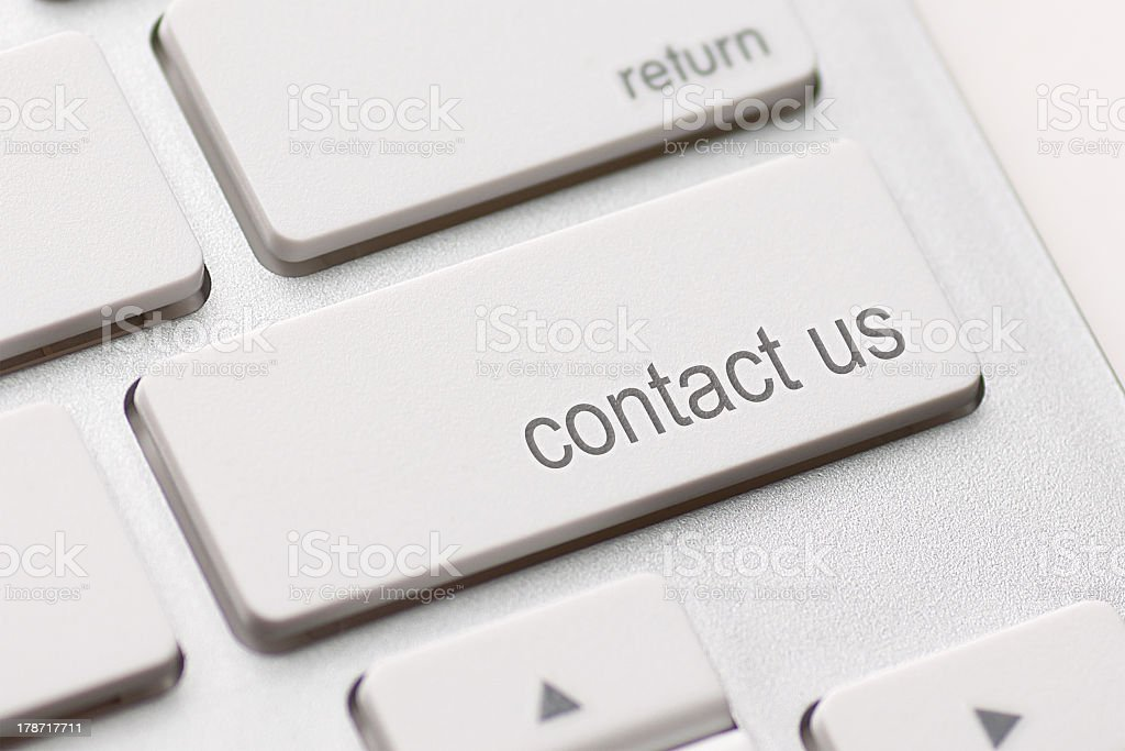 Contact us key on white keyboard stock photo