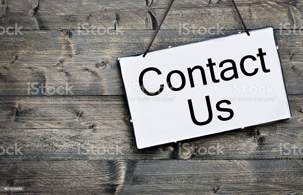 Contact Us on wooden table stock photo
