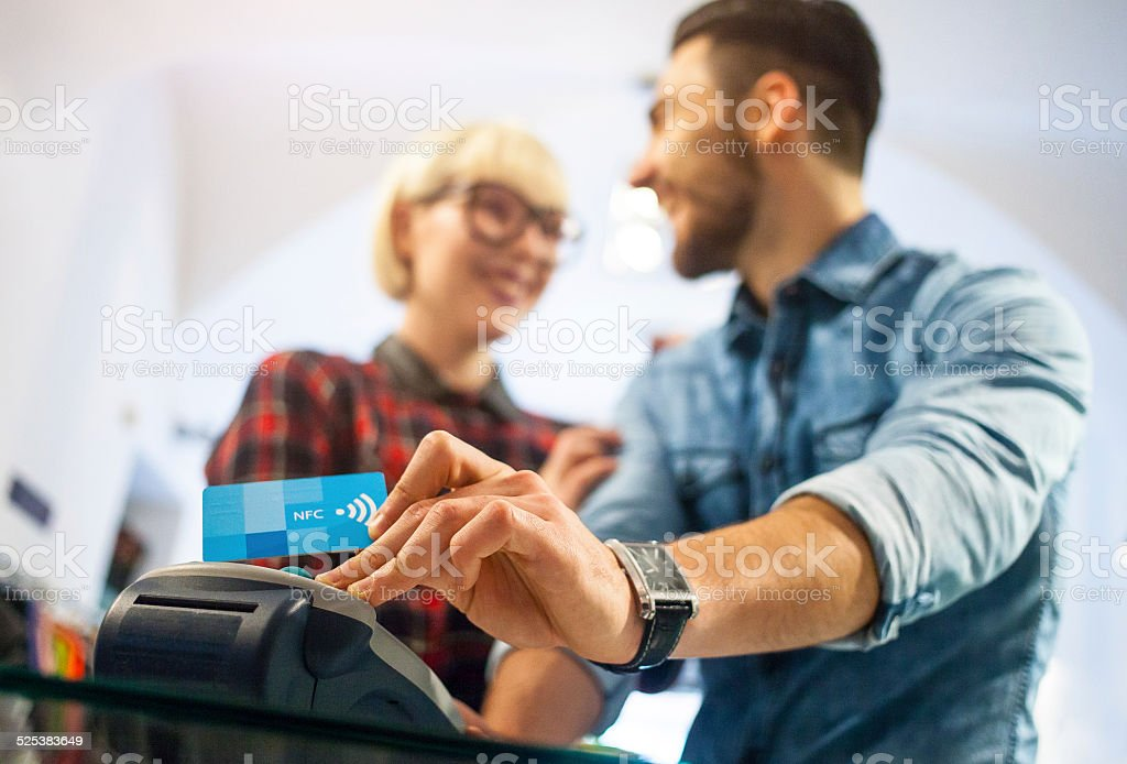 Contactless paying at the shop stock photo