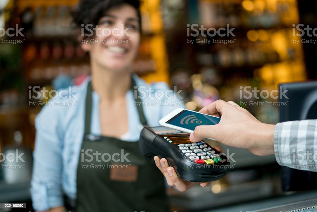Contactless payment at a restaurant stock photo