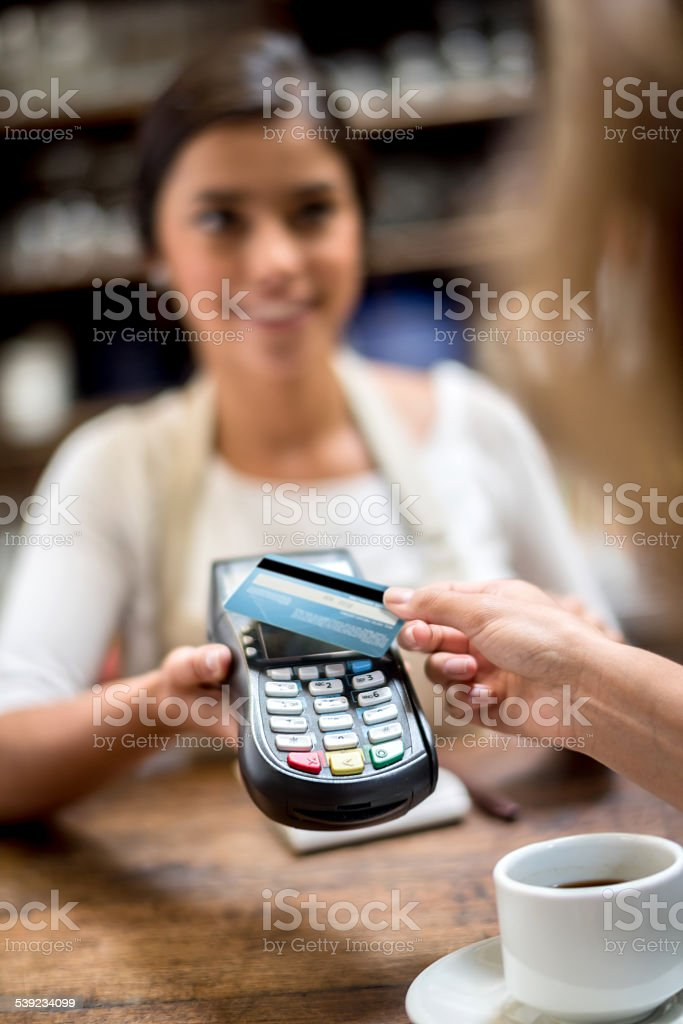 Contactless payment at the cafe stock photo