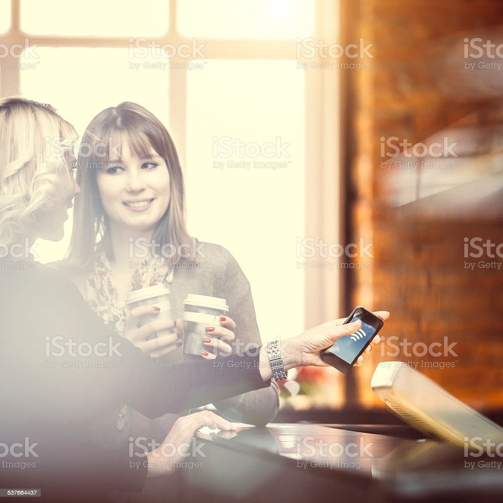 Contactless payment at the coffee bar stock photo