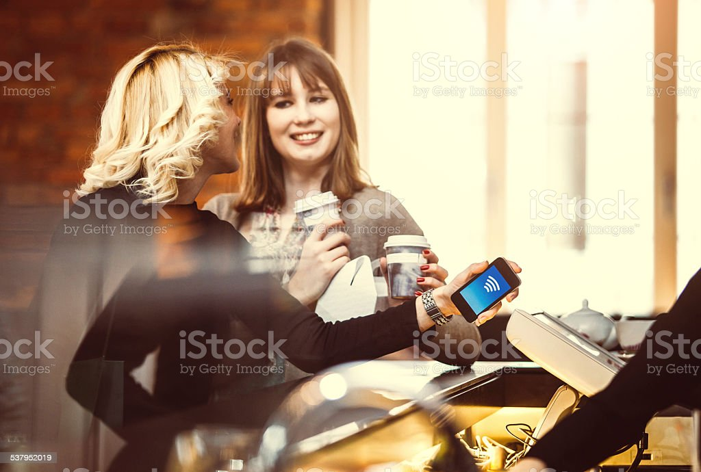 Contactless payment at the coffee shop stock photo