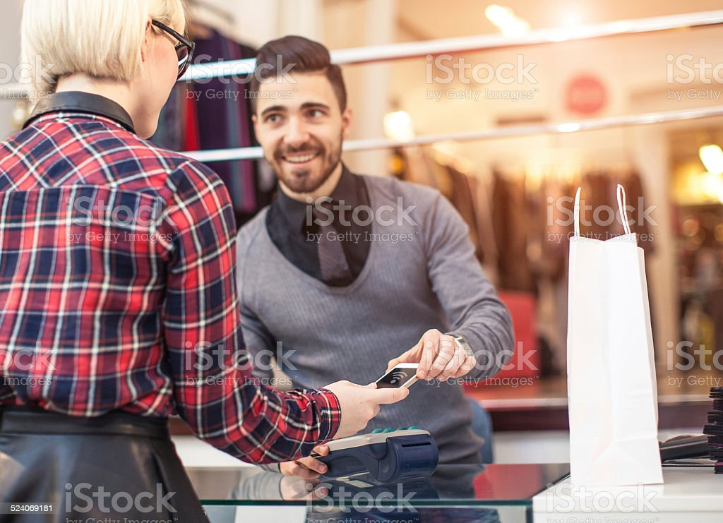 Contactless payment at the shop stock photo