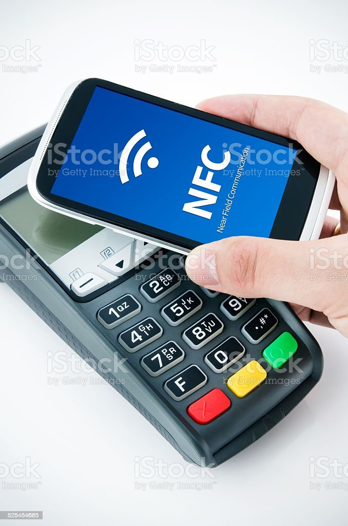 Contactless payment card with NFC chip in smart phone stock photo