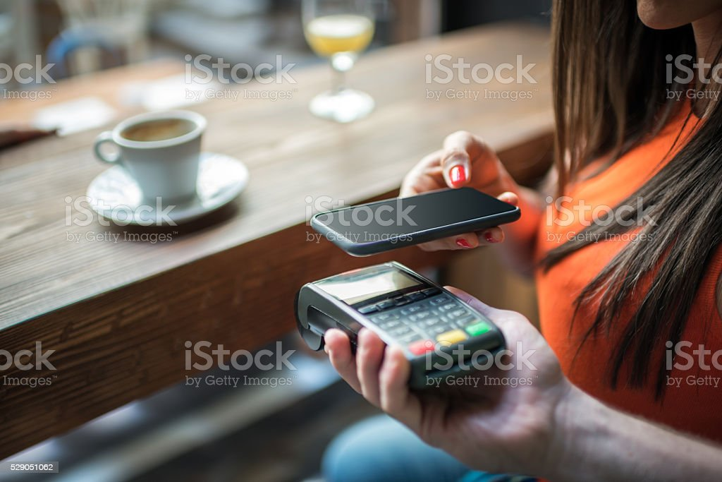 Contactless payment system with mobile phone stock photo