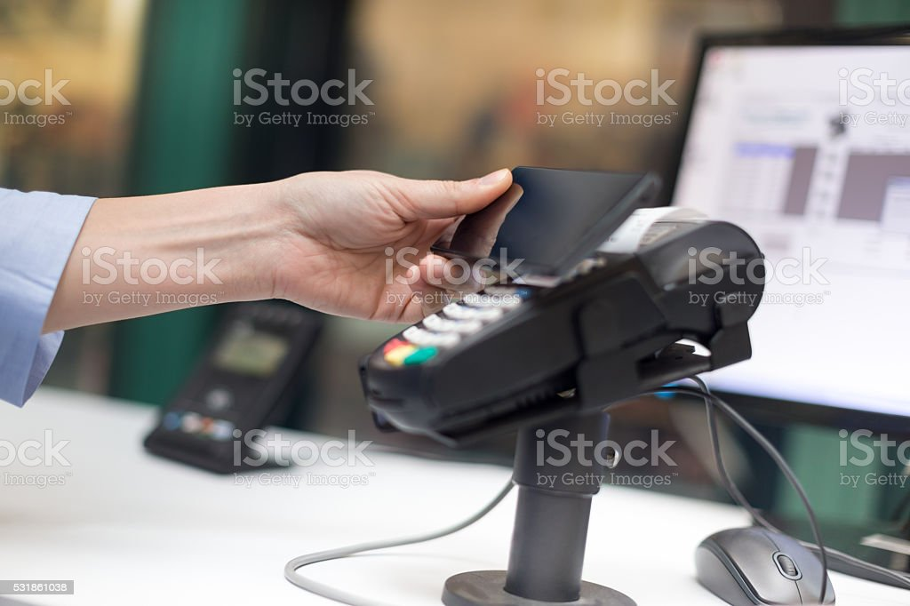 Contactless payment with smart phone stock photo