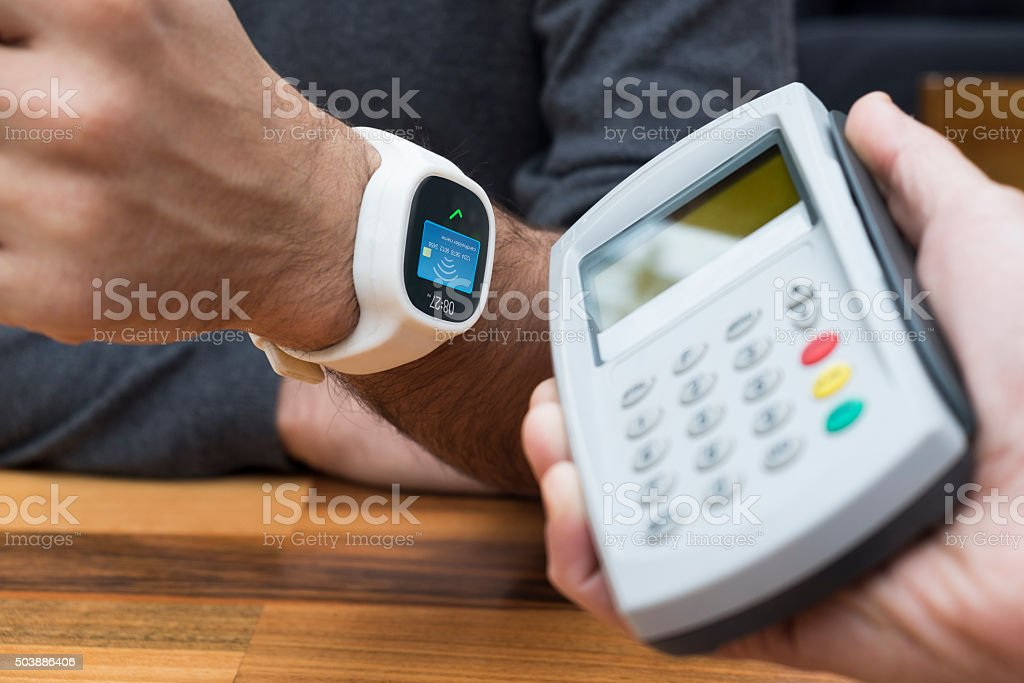 Contactless payment with smart watch stock photo