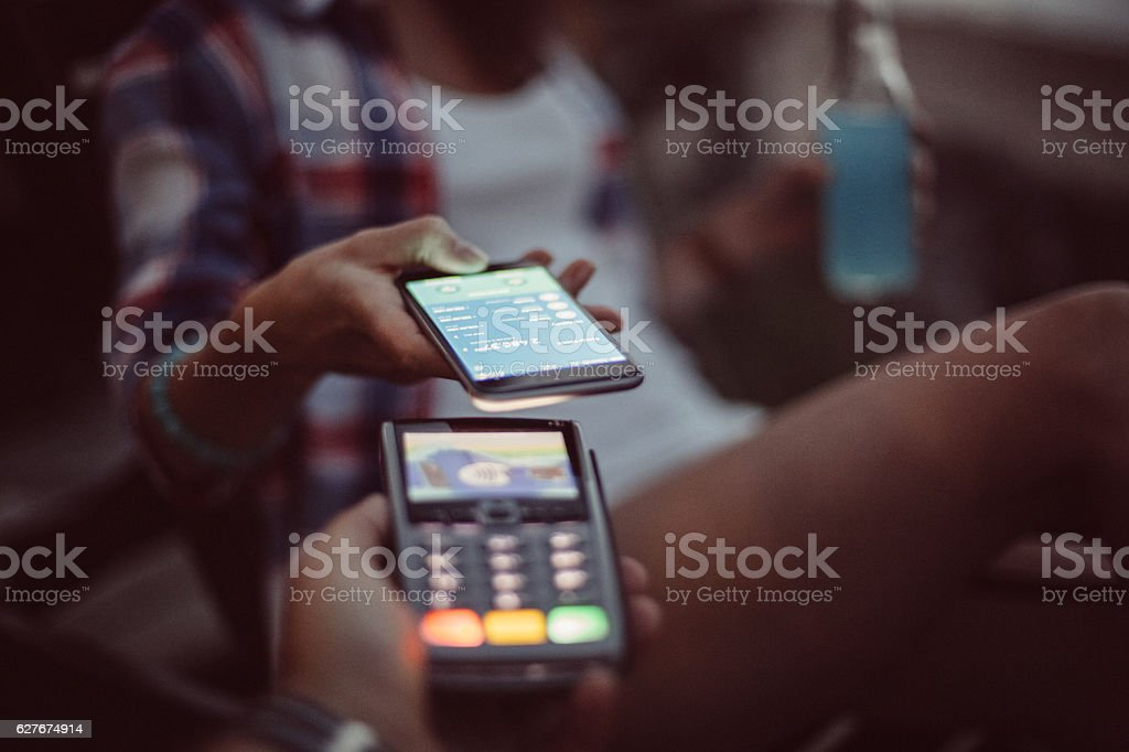 Contactless payment with smartphone stock photo