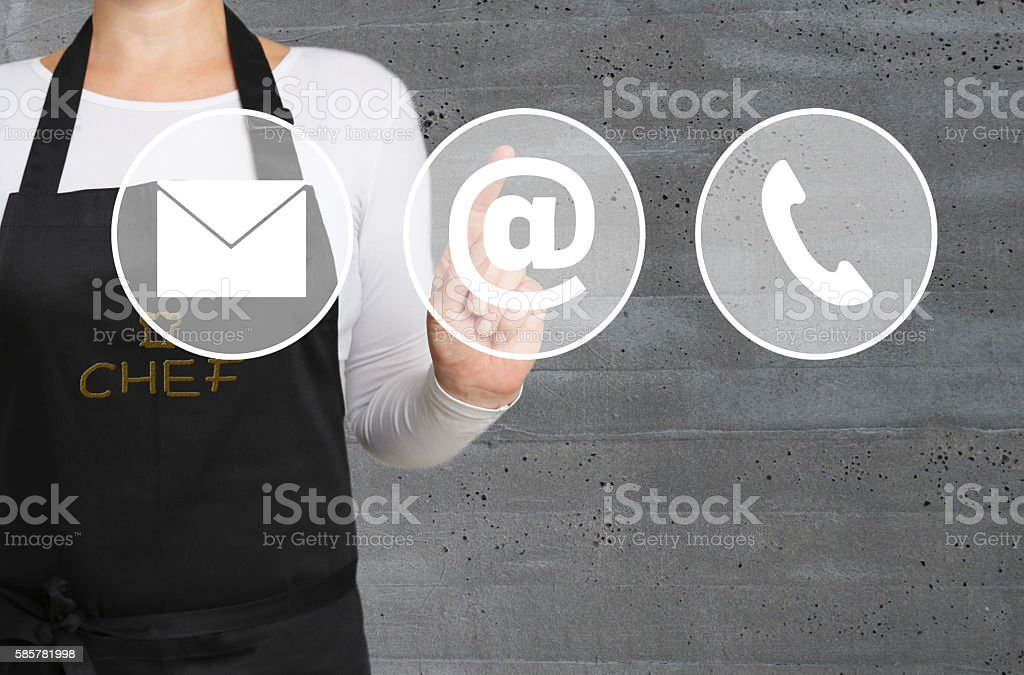 Contacts icon touchscreen is operated by chef stock photo