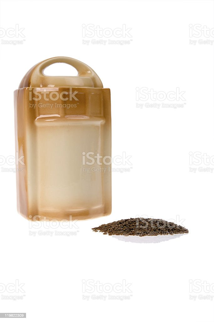 container and flaxseed royalty-free stock photo