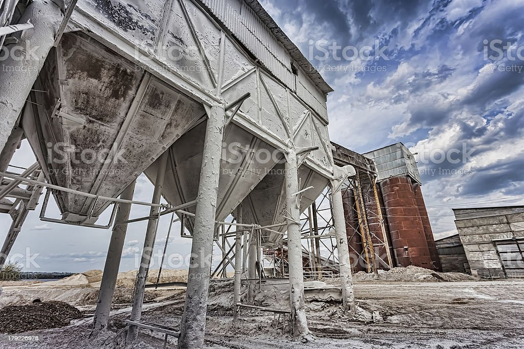 container at  plant for the production of building mixtures stock photo