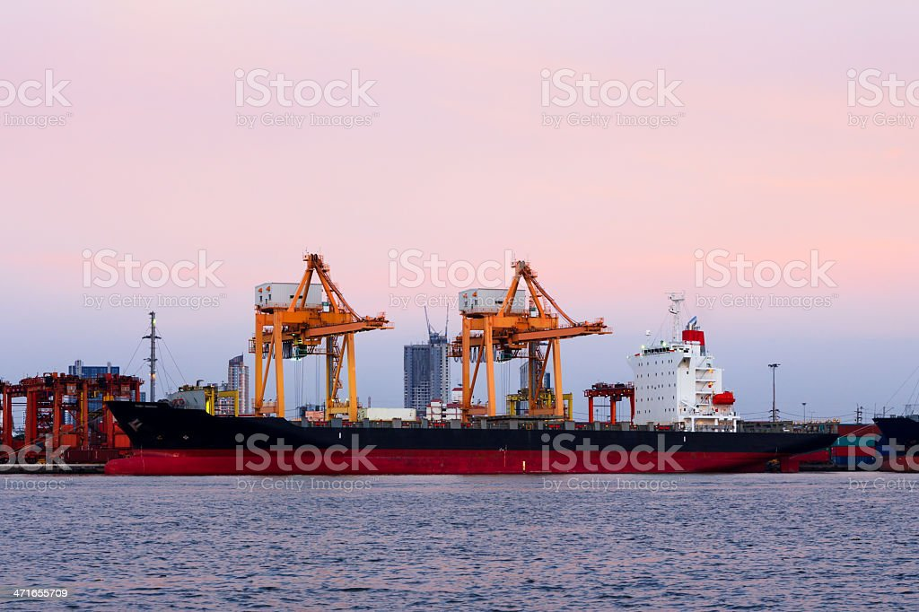 Container cargo freight ship at port during twilight royalty-free stock photo
