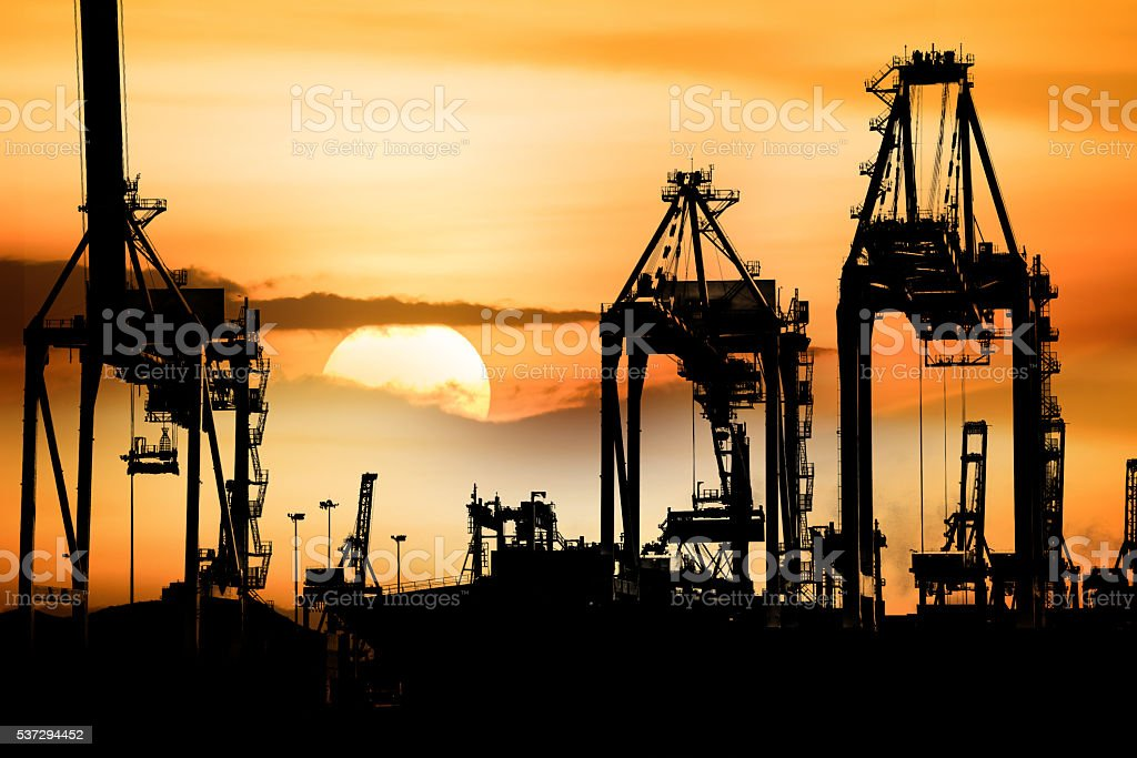 Container Cargo freight ship with working crane bridge in shipyard. stock photo