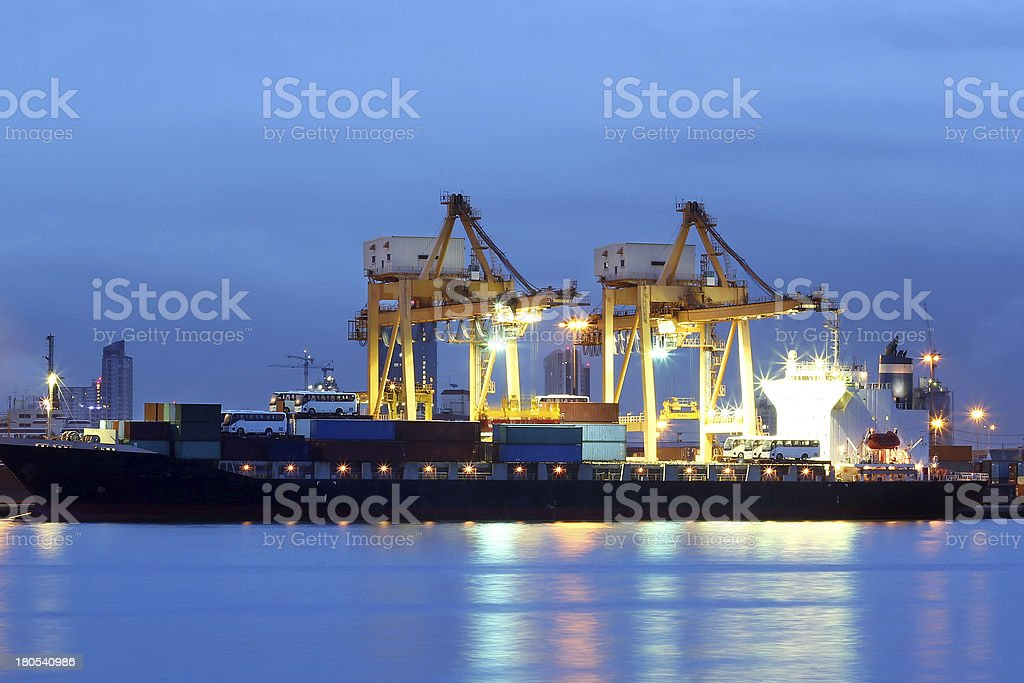 Container Cargo freight ship with working crane royalty-free stock photo