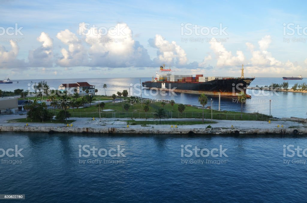Container Cargo Ship in Grand Bahamas Waterway stock photo