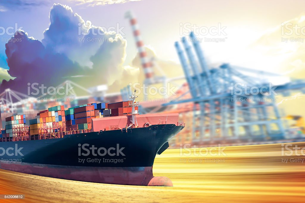 Container cargo ship motion blur  with harbor crane background. stock photo