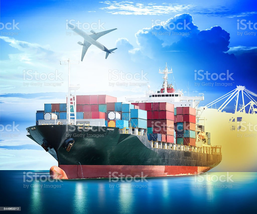 Container Cargo ship with ports crane bridge in harbor stock photo