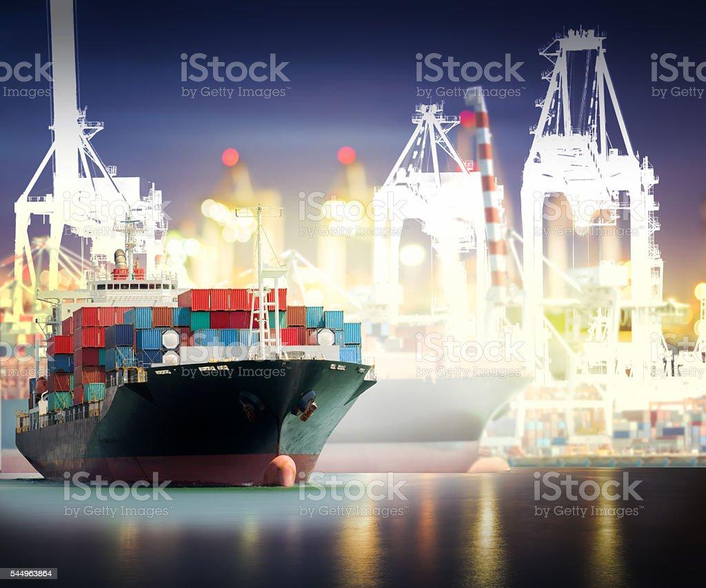 Container Cargo ship with ports crane bridge in harbor stock photo