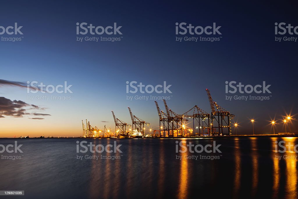 Container crane machinery in shipyard stock photo