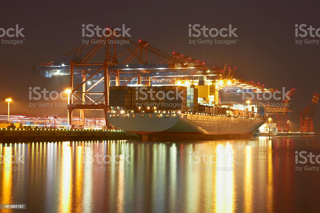 Container cranes in Hamburgs harbour, ship offloading stock photo