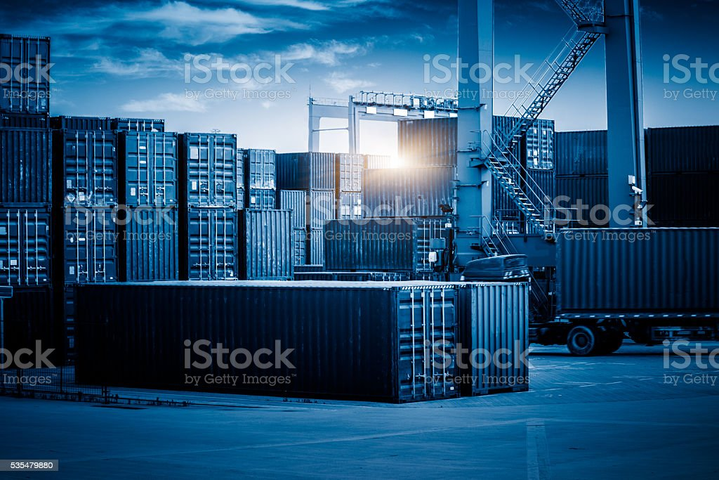 container freight station against sunbeam stock photo