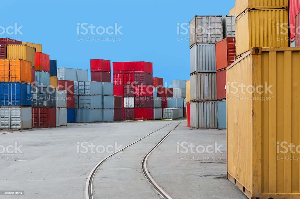 Container in a harbour with railtracks stock photo