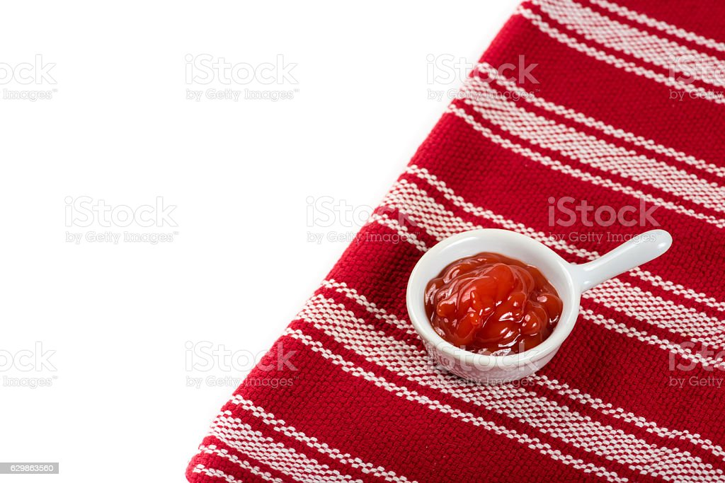 Container of ketchup on the table in natural light stock photo